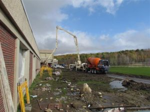 Concrete being pumped into the building