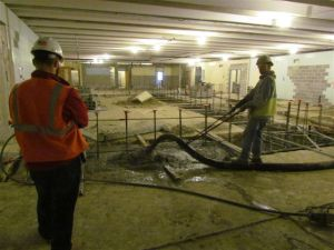 Concrete being poured for middle school lab floor